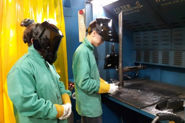 young students welding