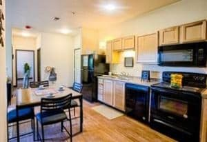 Interior of Vue Student Housing Apartment. View of Kitchen.