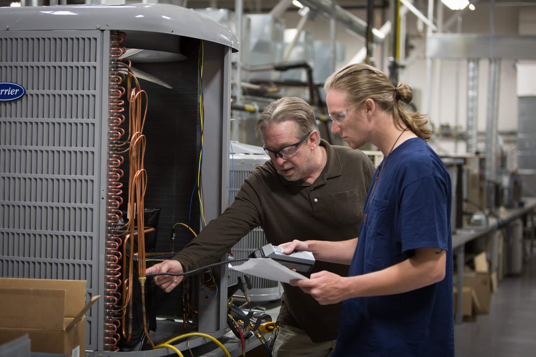 an HVAC instructor and student work together